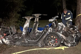 The wreck from the latest Tesla crash.. Authorities said that one man was found in the front passenger seat and a second in one of the rear seats - with no sign anyone was behind the wheel.