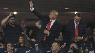 US President Donald Trump waves to the crowd during Game 5 of the World Series between the Washington Nationals and the Houston Astros at Nationals Park in Washington on Sunday.