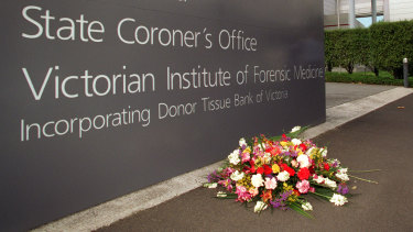 A wreath of flowers at the Coroners Court, laid during a previous coronial inquiry.