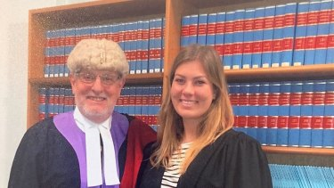 Judge Bob Sorby in chambers with daughter Bella.