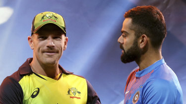 Aaron Finch, left, and Virat Kohli.