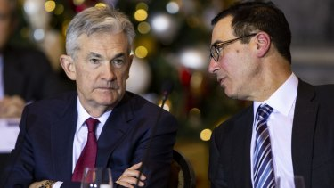 US Treasury secretary Steven Mnuchin, right, speaks with Jerome Powell, chairman of the US Federal Reserve, during a Financial Stability Oversight Council (FSOC) meeting in December.