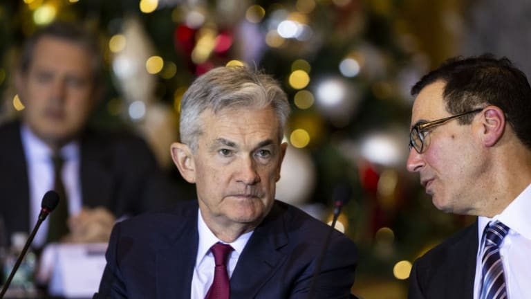 Steven Mnuchin, US Treasury secretary, right, speaks with Jerome Powell, chairman of the US Federal Reserve, during a Financial Stability Oversight Council (FSOC) meeting in Washington, DC, in December