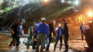One of the boys is seen being stretchered out of the cave on Tuesday night.