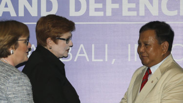 Indonesia's Defence Minister Prabowo Subianto, right, greets Foreign Minsiter Marise Payne and Defence Minister Linda Reynolds, left.