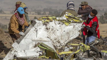 Rescue workers comb the scene of the Ethiopian Airlines crash.