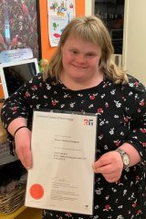Sharon Champion with her childcare certificate.