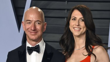 Jeff Bezos and his wife MacKenzie Bezos pictured last year, before the publication of salacious details of his affair.