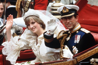 The Princess and Prince of Wales wave from their carriage on their wedding day.