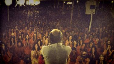 Bhagwan Shree Rajneesh with his followers.