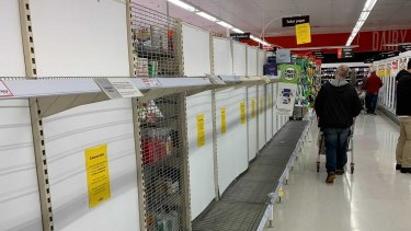 Queues building up and depleted toilet paper shelves at Forestville Coles.