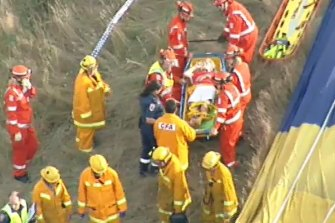 A person is put on a stretcher after the hot air balloon crash in the Yarra Valley on February 8, 2018.