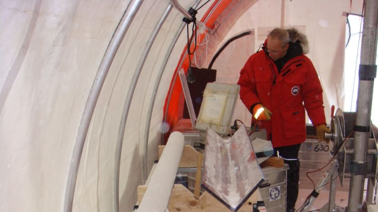 In a tent with an ice core.