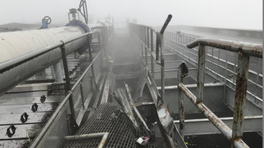 The damage caused by a helicopter crash on the roof of a New York office tower.