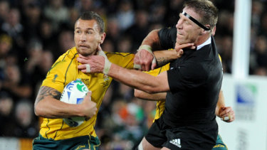 Quade Cooper fends off Thorn at the 2011 Rugby World Cup.
