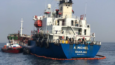 The damaged Emirati-flagged bunkering tanker A Michel off the coast of Fujairah, UAE.