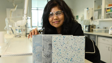 Professor Veena Sahajwalla with a display of the new building materials produced by the University of NSW from old clothing waste.