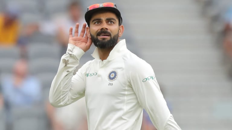 All ears: Virat Kohli gestures to the Perth crowd on day three of the second Test.