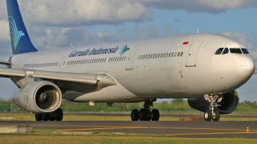 Garuda Indonesia had its business class service criticised by video bloggers who could now face defamation charges.
