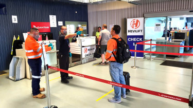 BHP workers receiving mandatory temperature checks at Moranbah airport.