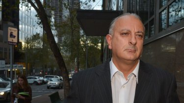 Former professional poker player Bill Jordanou leaves court in 2014.