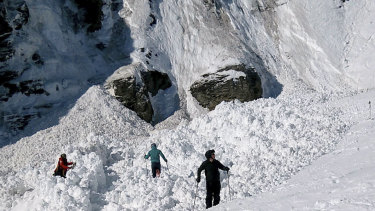 Rescue crews work work at the site of an avalanche site in the ski resort of Crans-Montana, Switzerland.