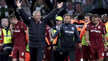 Cluj's manager Dan Petrescu celebrates victory after the final whistle in Glasgow.