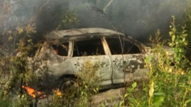 The burnt-out Toyota that fugitives Kam McLeod and Bryer Schmegelsky were travelling in.