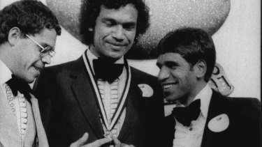 Stephen Michael (centre) in 1981 after winning his second Sandover Medal with a record 37 votes over Phil Narkle (left) and Jim Krakouer (right).