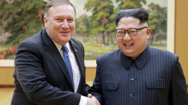 US. Secretary of State Mike Pompeo, left, shakes hands with North Korean leader Kim Jong-un in May.