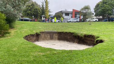 Emergency services are worried the sinkhole will get bigger as rain continues.