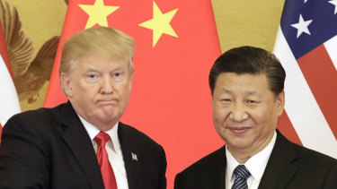 US President Donald Trump, left, and China's President Xi Jinping have been arguing about tarrifs.