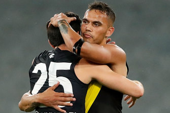 Richmond's Sydney Stack and Carlton's Zac Fisher hug after the game.