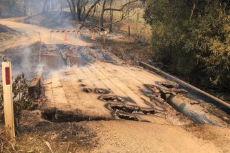 The bridge over South Arm creek was burnt out during last week's fires. Residents believe Mr Savva rolled his car when he was reversing away from the bridge.
