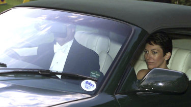 British socialite Ghislaine Maxwell, driven by Prince Andrew, leaves the wedding of a former girlfriend of the prince, Aurelia Cecil, in England in 2000.
