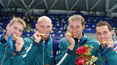 Todd Pearson, Michael Klim, Ian Thorpe and William Kirby celebrated gold for Australia after the 4x200m freestyle relay.