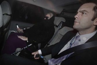 Judy Moran with Detective Senior Sergeant Stuart Bateson arriving at Melbourne Custody Centre in June 2009.