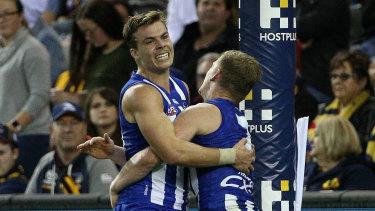 Cameron Zurhaar of the Kangaroos (left) celebrates a goal with teammate Jack Ziebell.