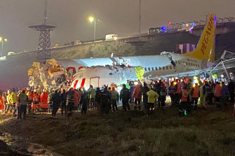 Passengers were seen evacuating through cracks in the plane following the crash.