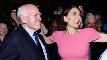 Premier Gladys Berejiklian with former prime minister John Howard at the Sofitel Wentworth after her NSW election victory on Saturday night.