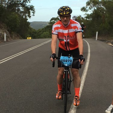 Peteris (in red) climbing a hill during Sydney's Bobbin Hill Classic Bike Ride in April 2016. Only four months later, the first symptoms of MND appeared.