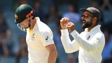 Shaun Marsh departs for 60 on day five as Virat Kohli celebrates.