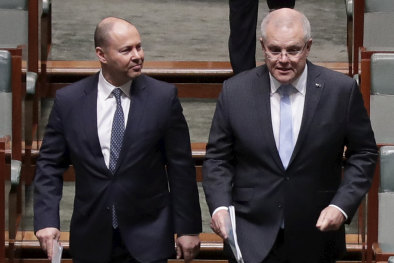 Josh Frydenberg and Scott Morrison enter the House of Representatives ahead of passing the government's $130 billion JobKeeper wage subsidy package.