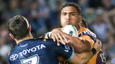 Tevita Pangai of the Broncos is tackled by Cowboys defence during the Round 21 NRL match between the North Queensland Cowboys and the Brisbane Broncos at 1300SMILES Stadium in Townsville, Thursday, August 8, 2019.  (AAP Image/Michael Chambers) NO ARCHIVING, EDITORIAL USE ONLY