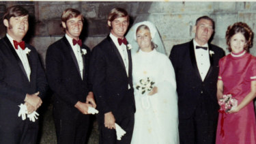 Chris and Lynette Dawson on their wedding day. His twin brother Paul is at left.