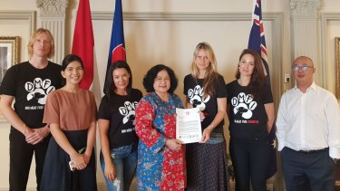 From left: Jeroen Van Kernebeek (Dog-Meat Free Indonesia); an unidentified consulate staff member; Kristie Wilkinson (DMFI); Zani Murnia, diplomat at Indonesian consulate-general in Sydney; Georgie Dolphin (DMFI); Jessica Medcalf (DMFI); Novan Ivanhoe Saleh, consul at Indonesian consulate-general in Sydney
