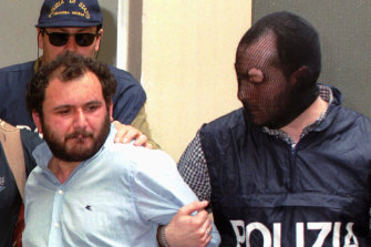 Giovanni Brusca, under arrest, pictured outside police headquarters in Palermo in 1996.
