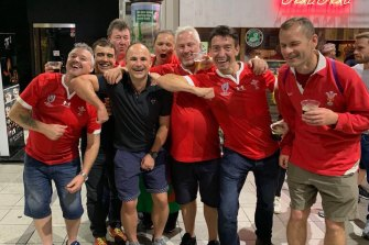 Referee Jaco Peyper (black shirt) has found himself in hot water after posing for this photo with Wales fans.