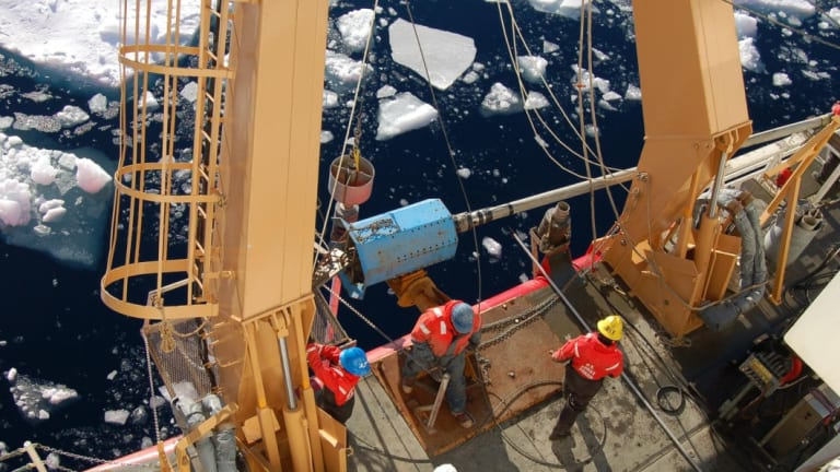 Researchers aboard the US Coast Guard Cutter Healy gather sediment cores from along the continental slope east of the Mackenzie River in the eastern Beaufort Sea. They were searching for evidence of a a huge glacial flood near where the Mackenzie River enters the Arctic Ocean,