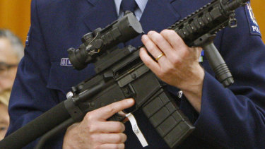 NZ acting police superintendent Mike McIlraith shows MPs in Wellington an AR-15 style rifle similar to one of the weapons a gunman used to slaughter 51 people at two Christchurch mosques in March.